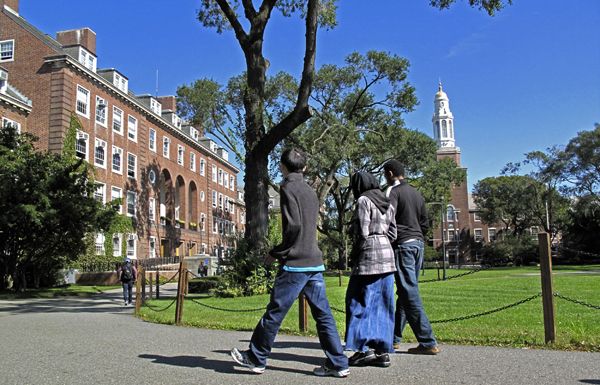 People walk on the campus of Brooklyn College in the Brooklyn borough of New York on Friday, Oct. 7, 2011.