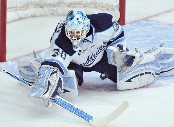 Dan Sullivan makes a save on a short that got between his pads during the first period of a game in Orono against Northeastern on Oct. 7, 2011. Maine won 6-3.