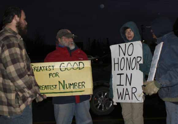 Supporters of the Occupy Aroostook movement gathered at the North Street parking lot Nov. 7 in preparation of their first march. Among participants were (from left) Troy Haines, Steve Demaio, Carol McKnight and John Cancelarich.