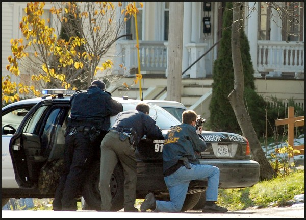 Members of the Maine Drug Enforcement Agency, U.S. Drug Enforcement Agency, Bangor Police Department and the Bangor special response team execute search warrants in the area of 100 Ohio St. on Nov. 3, 2011, after a drug investigation.
