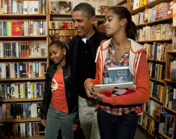 President Barack Obama visits Kramerbooks for shopping with his daughters Sasha and Malia (right) on Saturday, Nov. 26, 2011, in Washington.