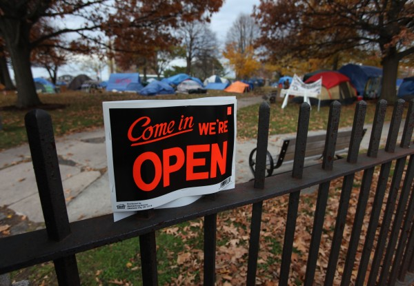 A sign welcoming people to the OccupyMaine encampment in Lincoln Park in Portland, Maine is seen Tuesday, Nov. 15, 2011. Protesters are preparing for the colder weather and vowing to stick it out through the winter.