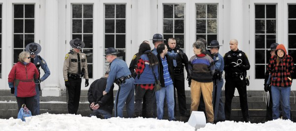 Protesters are arrested on the lawn of the Blaine House during a rally by Occupy Augusta, Sunday, Nov. 27, 2011, in Augusta. Police say eight people were charged with criminal trespass and failure to disperse after refusing to leave the lawn of the governor's mansion.