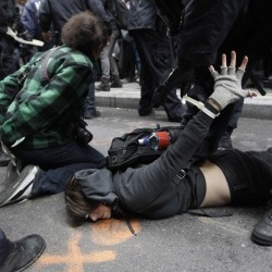 Police officers arrest a demonstrators affiliated with the Occupy Wall Street movement, Thursday, Nov. 17, 2011, in New York. Two days after the encampment that sparked the global Occupy protest movement was cleared by authorities, demonstrators marched through New York's financial district and promised a national day of action with mass gatherings in other cities.