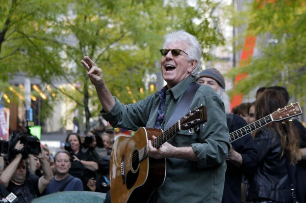 Graham Nash (left) and David Crosby (rear) perform a free acoustic concert of protest songs at Occupy Wall Street's Zuccotti Park encampment in New York, Tuesday, Nov. 8, 2011.