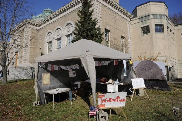 In compliance with the city's request, Occupy Bangor's information tent, pictured Monday morning, Nov. 21, 2011, was moved Sunday afternoon to the front lawn of the Bangor Public Library from its previous adjacent Peirce Park location.