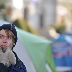 Standing in Peirce Park, Chris DesRoches, a spokesperson with Occupy Bangor, surveys the group's encampment on the grounds of Bangor Public Library on Monday morning, Nov. 21, 2011.
