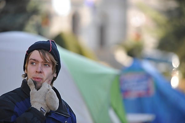 Standing in Peirce Park, Chris DesRoches, a spokesperson with Occupy Bangor, surveys the group's encampment on the grounds of Bangor Public Library on Nov. 21, 2011.