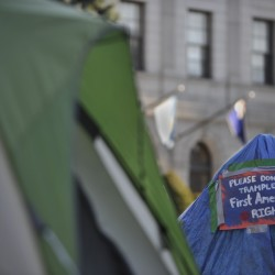 Occupy Bangor's makeshift tarp tent (right), as well as another tent (foreground, left) remained in Peirce Park on Monday morning, Nov. 21, 2011. The tents were erected Sunday, and one in the foreground was occupied overnight by four participants as a First Amendment protest against city officials' request that the group remove all structures from the site by late Sunday.