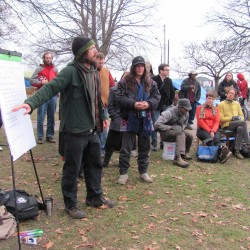 Jonah Fertig goes over the agenda for a meeting Sunday, Nov. 27, 2011, among OccupyMaine activists. The goal of the meeting was for the group to decide what steps it will take next in terms of remaining at Lincoln Park.