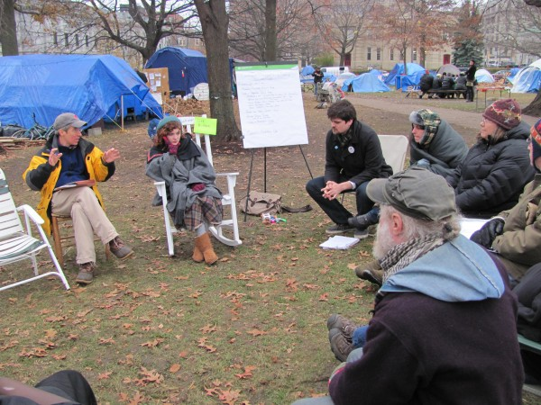 Portland-based attorney John Branson (left) provides legal advice to members of the OccupyMaine movement, who have lived in an encampment in Lincoln Park since early October. The group was attempting to make decisions on Sunday, Nov. 27, 2011, that will affect the future of the encampment.