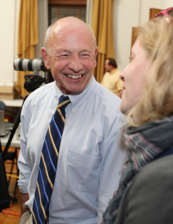 Michael Brennan (left) is congratulated by Delia Gorham (right) of the League of Young Voters, after being named the unofficial winner of Portland's mayoral race Wednesday, Nov. 9, 2011, in Portland, Maine.