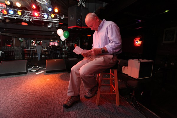 Michael Brennan looks over a breakdown of election results on Election Day.