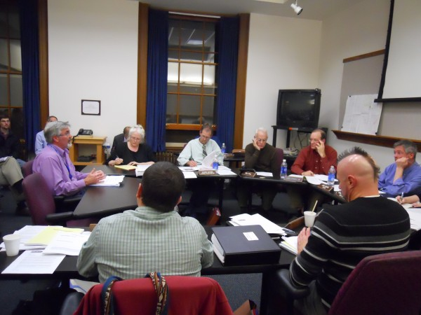 Preble Street Executive Director Mark Swann (far left, in purple) addresses the Portland Planning Board on Tuesday night about the organization's plan to relocate its teen shelter to a new building at 38 Preble St.