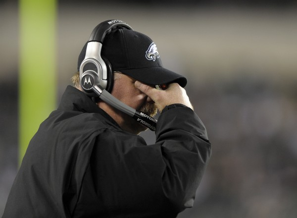 Philadelphia Eagles head coach Andy Reid adjusts his glasses during the second half of an NFL football game with the New England Patriots on Sunday, Nov. 27, 2011, in Philadelphia. The Patriots won 38-20.