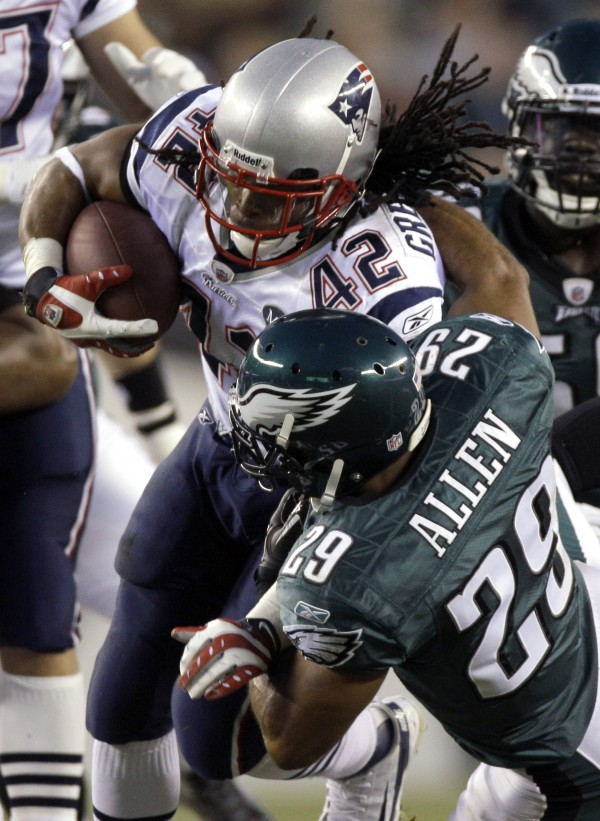 New England Patriots running back BenJarvus Green-Ellis (42) is tackled by Philadelphia Eagles free safety Nate Allen (29) during the first half of an NFL football game on Sunday, Nov. 27, 2011, in Philadelphia.