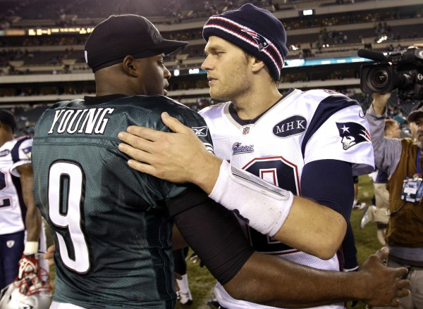 Philadelphia Eagles quarterback Vince Young greets New England Patriots quarterback Tom Brady after an NFL football game on Sunday, Nov. 27, 2011, in Philadelphia. The Patriots won 38-20.