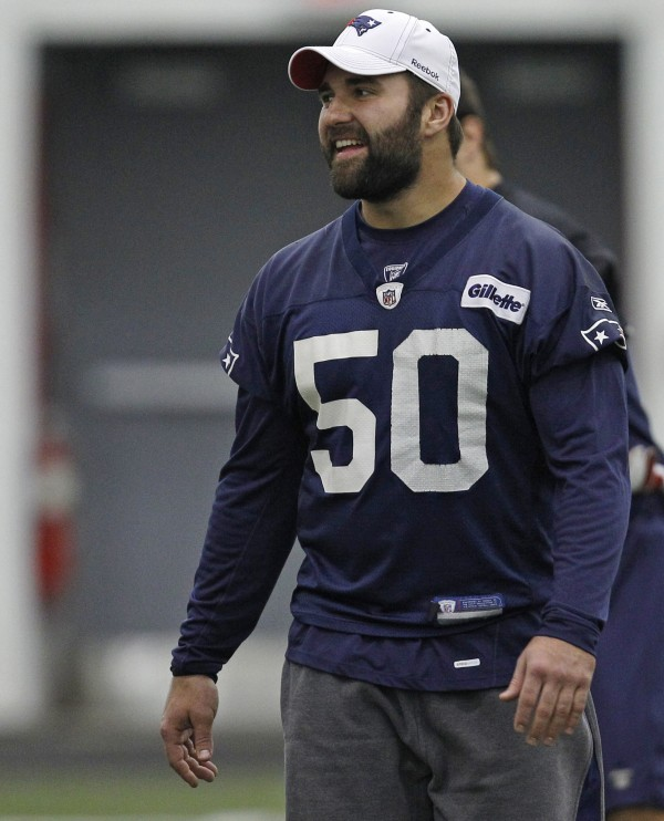 New England Patriots linebacker Rob Ninkovich walks onto the practice field during an NFL football work out with teammates in Foxborough, Mass., Wednesday, Nov. 16, 2011.