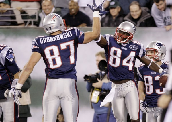 New England Patriots' Deion Branch (84) celebrates with teammate Rob Gronkowski (87) after scoring a touchdown during the fourth quarter of an NFL game against the New York Jets Sunday night, Nov. 13, 2011, in East Rutherford, N.J.