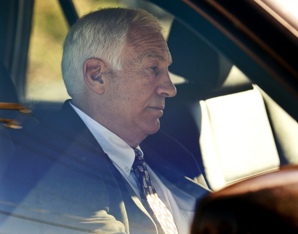 In this Nov. 5, 2011 file photo, former Penn State football defensive coordinator Gerald &quotJerry&quot Sandusky sits in a car as he leaves the office of Centre County Magisterial District Judge Leslie A. Dutchcot in State College, Pa.