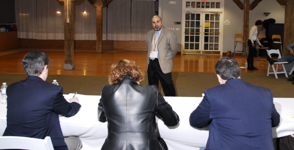 Enrique &quotRick&quot Sales, president of Abierto Networks in Eliot, makes his business pitch to a group of judges on Saturday, Nov. 5, 2011, at the Juice Conference in Camden. Companies were competing for $100,000 in convertible debt.