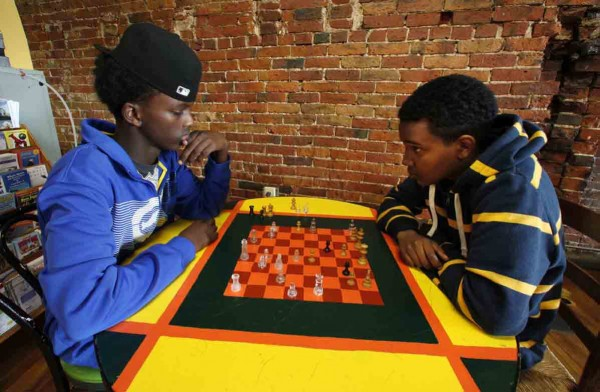 Ace Ali (left) and Muhamed Jamal, both 18, start their day off with a game of chess at the Public Market House.