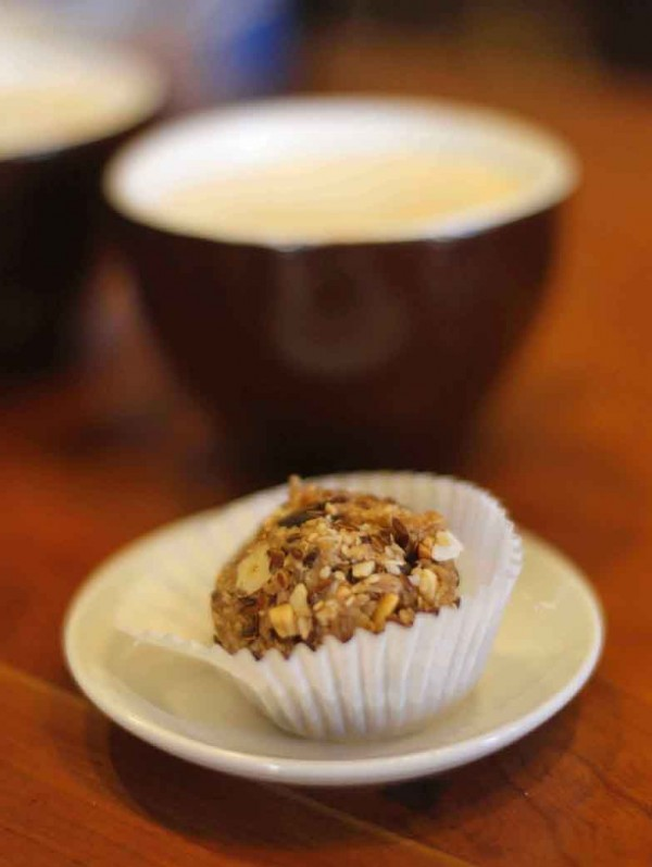 An &quotEnergy Ball&quot consisting of nuts, chocolate, flax, peanut butter and honey, is served with coffee at Market House Coffee on the second floor of the Public Market House.