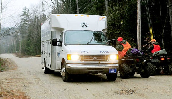 Wardens stop to speak with a Maine State Police mobile command unit approaching the scene of a shooting on Cedar Lane in Rumford on Thursday.