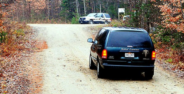 A van from the Medical Examiner's office approaches a bend in Cedar Lane in Rumford that will take them to Eric Richard's home in Rumford on Thursday.