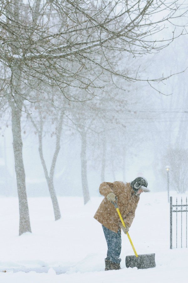 Ray Bussiere shovels his walkway at his home on Royal Road in Bangor on Wednesday, November 23, 2011.