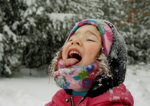Hailee Dearborn, 3, of Dedham catches snowflakes on her tongue while enjoying a day of play out in Wednesday's snowstorm.