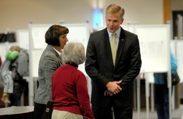 Maine Secretary of State Charlie Summers stops into the polls at the Bangor Civic Center Tuesday morning to visit election officials and voters before making his way back to Scarborough.