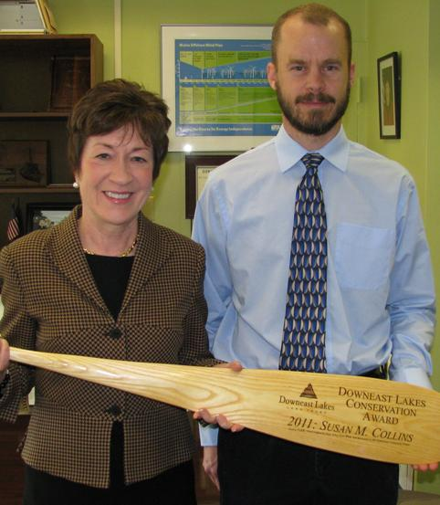 Senator Susan Collins receives Downeast Lakes Conservation Award from Mark Berry