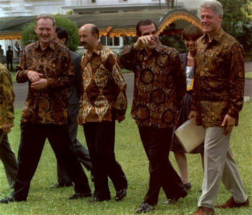 Clinton started the &quotsilly shirts&quot tradition, often representing the host country's culture.