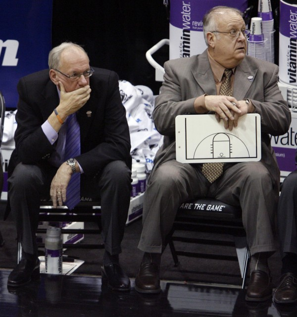 Syracuse coach Jim Boeheim, left, and associate head basketball coach Bernie Fine sit on the bench at the end an NCAA West Regional semifinal college basketball game against Butler in Salt Lake City on March 25, 2010. Fine was fired Sunday, Nov. 27, 2011, in the wake of an investigation of child molestation allegations against him.