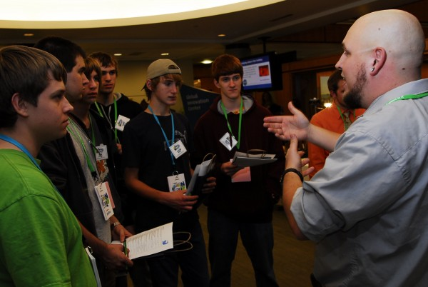Dan Allen, a developer in Unum's Data Warehouse, talks to a half dozen high school students about using Google analytics to monitor users on a website at the company's Tech Night on Nov. 15, 2011.