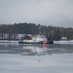 Rockland-based Coast Guard Cutter assists cargo ship beset in ice in Lake Michigan