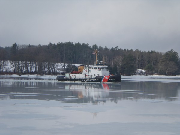 Coast Guard Cutter Thunder Bay breaks ice along the Kennebec River near the Richmond Bridge in Maine on Saturday, March 12, 2011.