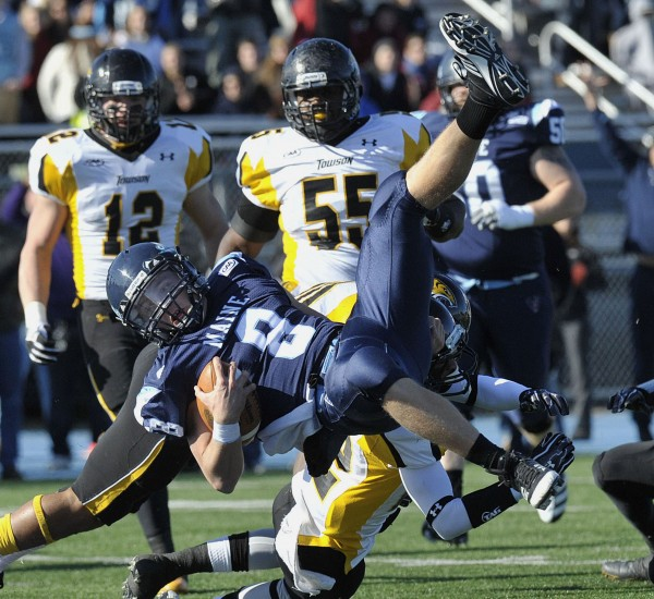 Maine quarterback Warren Smith (8) scores in the first half of an NCAA football game agianst Maine, in Orono on Saturday, Nov.5, 2011.