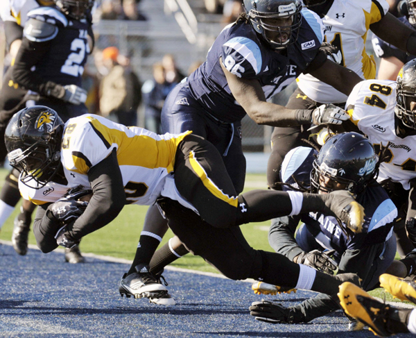 Towson University running back Terrence West scores against Maine in the first half of Saturday's college football game in Orono. The Black Bears had difficulty containing the Towson running game, which led directly to Towson's 40-30 victory.