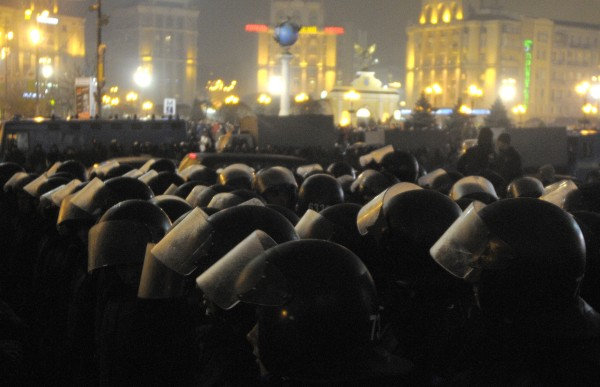 Ukrainian riot police arrive in the center of Kiev, Ukraine during an event marking of the seventh anniversary of the Orange Revolution on Tuesday, Nov. 22, 2011.