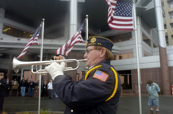 Charles Falcheck, a member of American Legion Ashley Post 673, plays taps during a Veterans Day ceremony on Thursday, Nov. 10, 2011, at the Department of Veterans Affairs Medical Center in Wilkes-Barre, Pa.