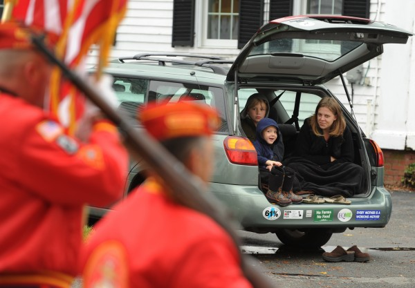 Iyisa Gardner (right) and her children, Daniel, 4, and Christopher, 10, watch the Veterans Day parade from the comfort of their hatchback along Wilson Street in Brewer on Friday, November 11, 2011.