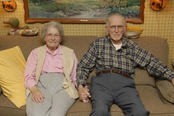 Wayne and Winona Dennison hold hands as they sit in the living room of their Ellsworth home. They met in the early 1940s when their families spent time at a Methodist campground in East Machias. Married in June 1946, they both worked as educators and later settled in Ellsworth in 1958.