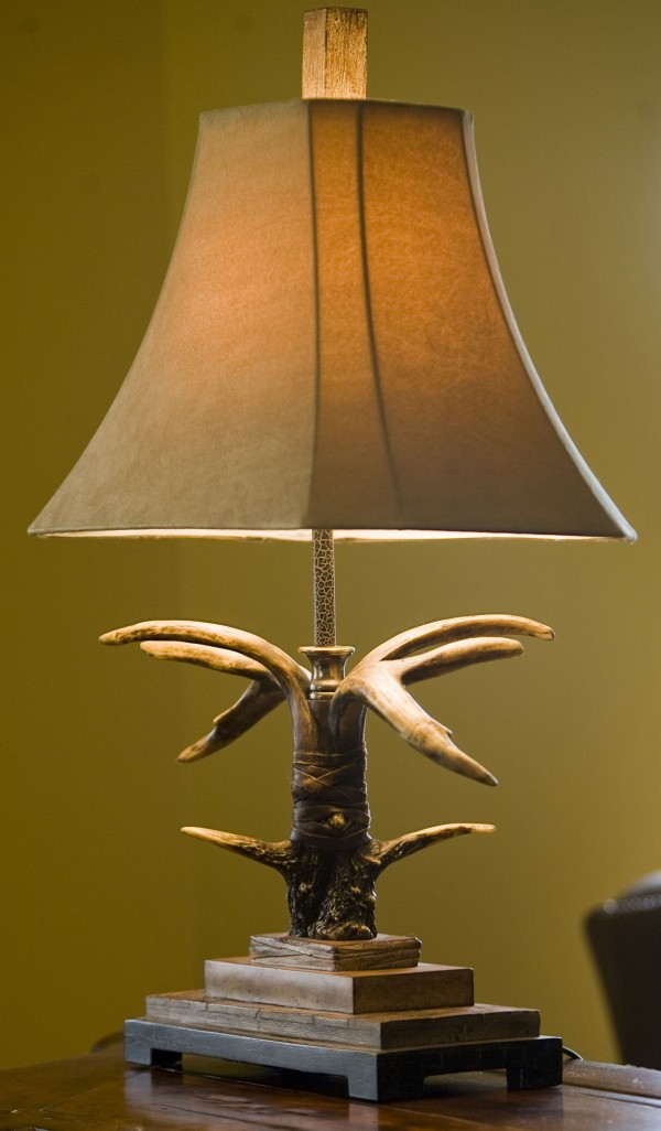 This condo in Kansas City, Missouri, features antlered light fixtures and lamps on Tuesday, October 18, 2011.