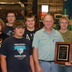 Rich Barratt (third from right) shows off his award to his morning Machine Shop class (from left) Owen Thompson, Sean Long, Tom Smalley, Seth Batty, Barratt, Ben Bruce and Cade Patten.