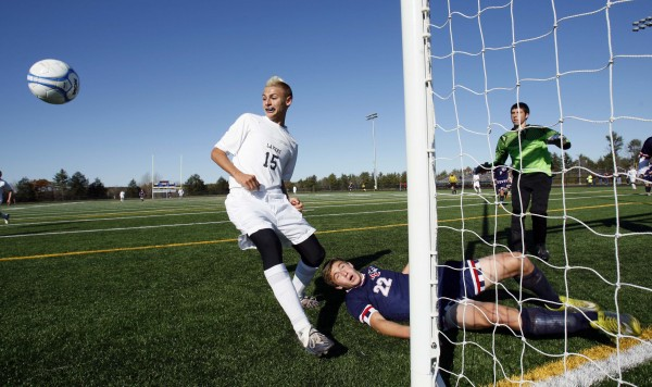 Bangor Christian's Ben Miller ends up on the ground after battling Greenville's Matthew DiAngelo (left) for a corner kick in the Class D soccer state championship in Falmouth on Saturday, Nov. 5, 2011.