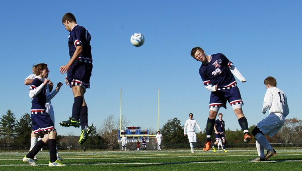 Bangor Christian's Jay Bishop (right) heads away a Greenville corner kick in the Class D soccer state championship in Falmouth on Saturday, Nov. 5, 2011.