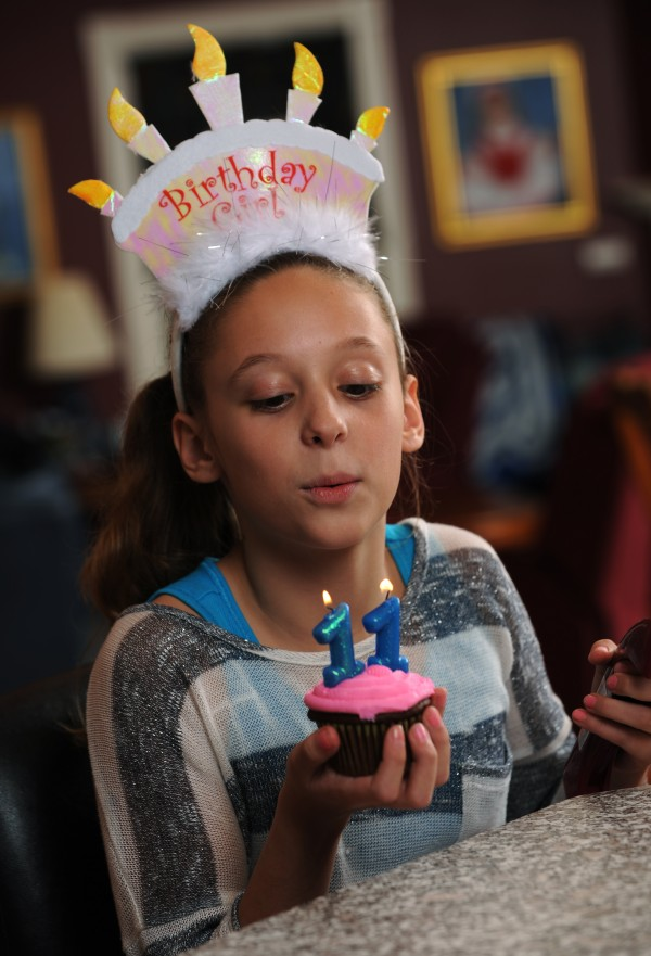 Maddie Brookings of Bangor blows out candles on a cupcake her mother made as a test for her upcoming birthday party. Brookings turns 11 years old on Nov. 11, 2011. She has been planning her celebration for several years including a private party of 11 of her closes friends.