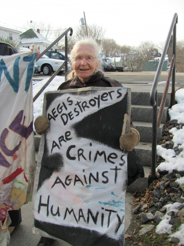 Loukie Lofchee, 89, of Brunswick, has been an anti-war activist for some 70 years. She was among about a dozen people who protested across the street from Bath Iron Works on Saturday, Nov. 26, 2011, opposing the company's mission of building guided-missile destroyers.